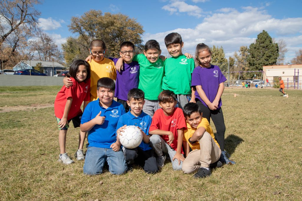 Students outside with a soccer ball at Eagleton.